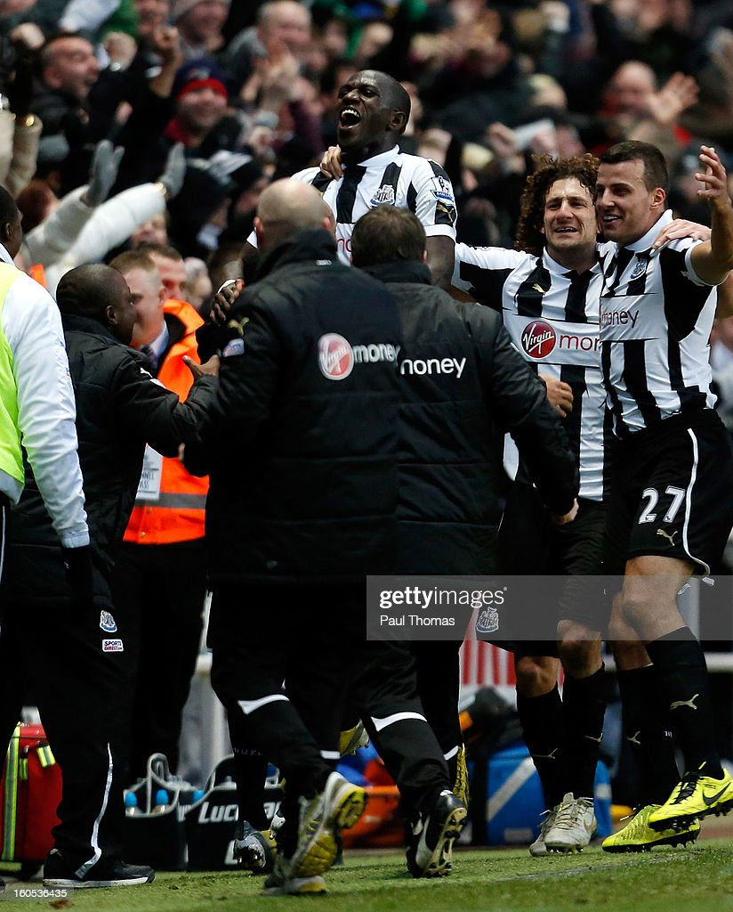 Moussa Sissoko (C) of Newcastle celebrates his goal with team mates and staff during the Premier League match between Newcastle United and Chelsea at St James Park on February 2, 2013 in Newcastle, England.