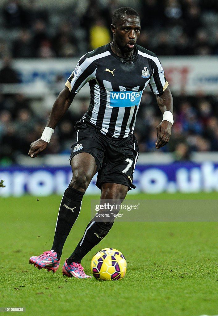 Moussa Sissoko of Newcastle runs with the ball from Shane Long of Southampton during the Barclays Premier League match between Newcastle United and Southampton at St.James' Park on January 17, 2015, in Newcastle upon Tyne, England.