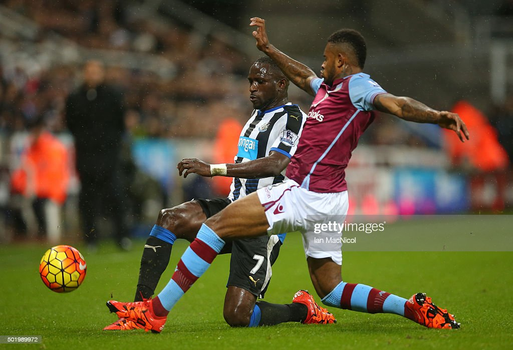 Moussa Sissoko of Newcastle United and Leandro Bacuna of Aston Villa compete for the ball during the Barclays Premier League match between Newcastle United and Aston Villa at St James' Park on December 19, 2015 in Newcastle upon Tyne, England.