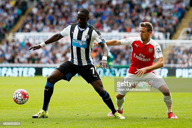 Moussa Sissoko of Newcastle United and Nacho Monreal of Arsenal compete for the ball during the Barclays Premier League match between Newcastle...