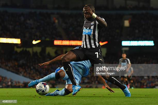 Moussa Sissoko of Newcastle United evades the tackle from Fernandinho of Manchester City to score their second goal during the Capital One Cup Fourth...