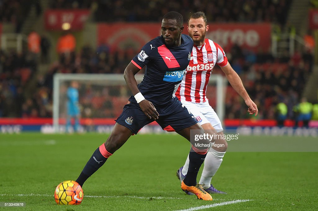 Moussa Sissoko of Newcastle United holds off Erik Pieters of Stoke City during the Barclays Premier League match between Stoke City and Newcastle United at the Britannia Stadium on March 2, 2016 in Stoke on Trent, England.