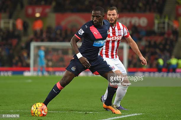 Moussa Sissoko of Newcastle United holds off Erik Pieters of Stoke City during the Barclays Premier League match between Stoke City and Newcastle...