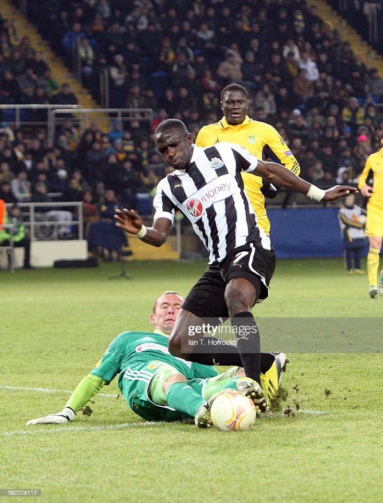 <a gi-track='captionPersonalityLinkClicked' href=/galleries/search?phrase=Moussa+Sissoko&family=editorial&specificpeople=4191251 ng-click='$event.stopPropagation()'>Moussa Sissoko</a> of Newcastle United is brought down by Metalist keeper Olexandr Goryainov during the UEFA Europa League round of 32 second leg match between FC Metalist Kharkiv and Newcastle United FC at Metalist Stadium, on February 21, 2013 in Kharkov, Ukraine.