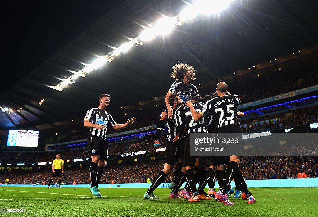 Moussa Sissoko of Newcastle United is mobbed by team mates after scoring their second goal during the Capital One Cup Fourth Round match between Manchester City and Newcastle United at Etihad Stadium on October 29, 2014 in Manchester, England.