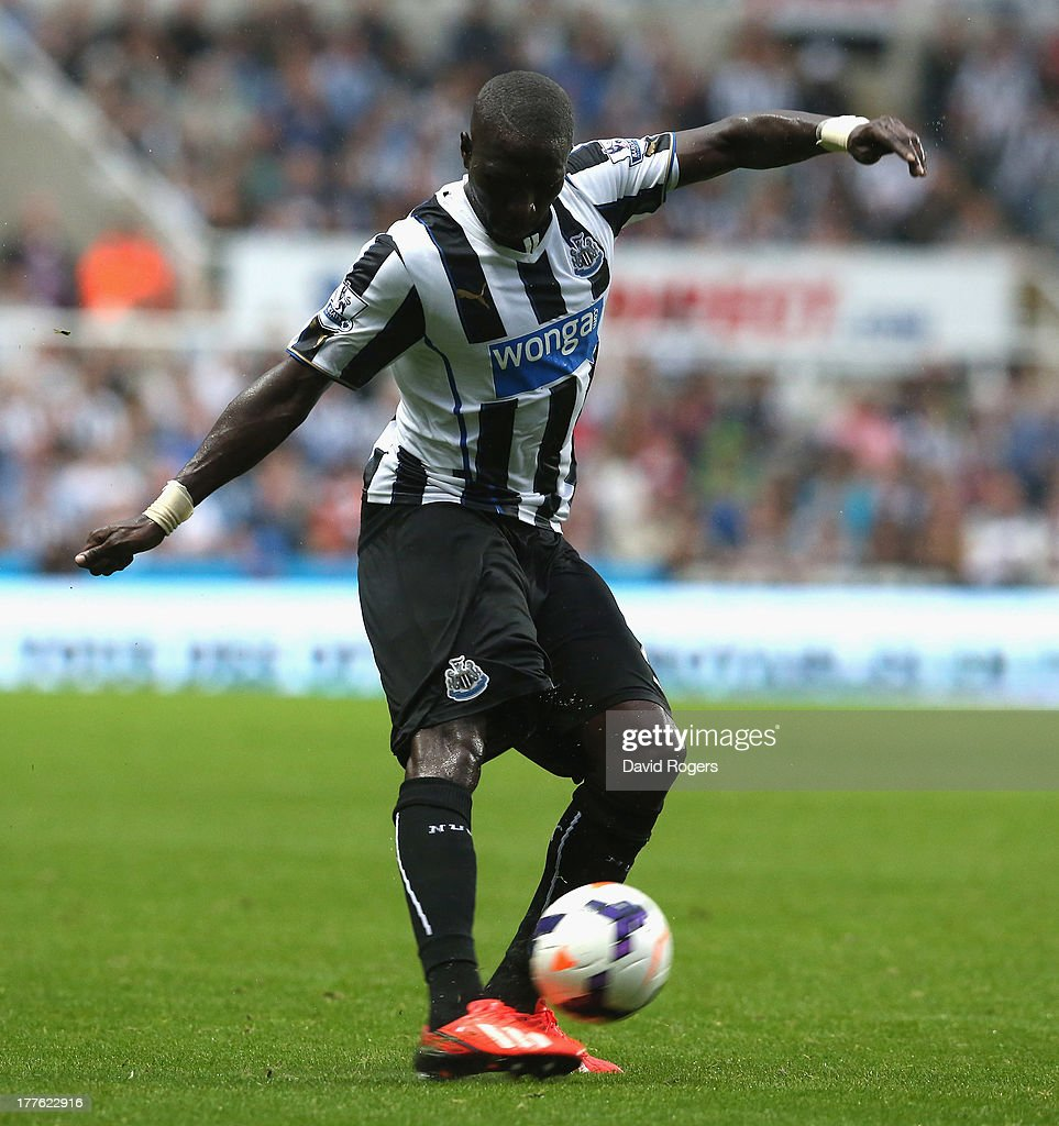 Moussa Sissoko of Newcastle United runs with the ball during the Barclays Premier League match between Newcastle United and West Ham United at St James' Park on August 24, 2013 in Newcastle upon Tyne, England.