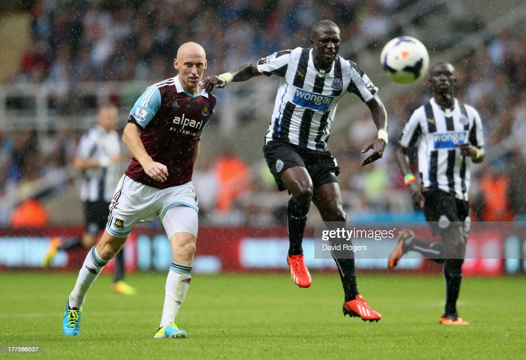 <a gi-track='captionPersonalityLinkClicked' href=/galleries/search?phrase=Moussa+Sissoko&family=editorial&specificpeople=4191251 ng-click='$event.stopPropagation()'>Moussa Sissoko</a> of Newcastle United takes a shot watched by <a gi-track='captionPersonalityLinkClicked' href=/galleries/search?phrase=James+Collins+-+Welsh+Soccer+Player&family=editorial&specificpeople=15167252 ng-click='$event.stopPropagation()'>James Collins</a> challenges during the Barclays Premier League match between Newcastle United and West Ham United at St James' Park on August 24, 2013 in Newcastle upon Tyne, England.