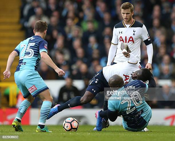 Moussa Sissoko of Tottenham Hotspur and Adebayo Akinfenwa of Wycombe Wanderers compete for the ball during the Emirates FA Cup Fourth Round match...