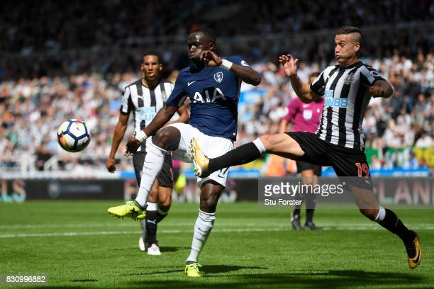 Moussa Sissoko of Tottenham Hotspur and Florian Lejeune of Newcastle United battle for possession during the Premier League match between Newcastle...