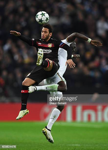 Moussa Sissoko of Tottenham Hotspur and Hakan Calhanoglu of Bayer Leverkusen in action during the UEFA Champions League Group E match between...