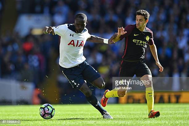 Moussa Sissoko of Tottenham Hotspur and Jesus Navas of Manchester City battle for possession during the Premier League match between Tottenham...