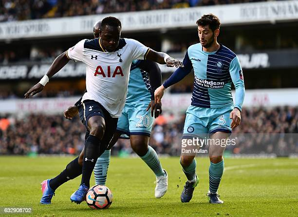 Moussa Sissoko of Tottenham Hotspur and Joe Jacobson of Wycombe Wanderers compete for the ball during the Emirates FA Cup Fourth Round match between...