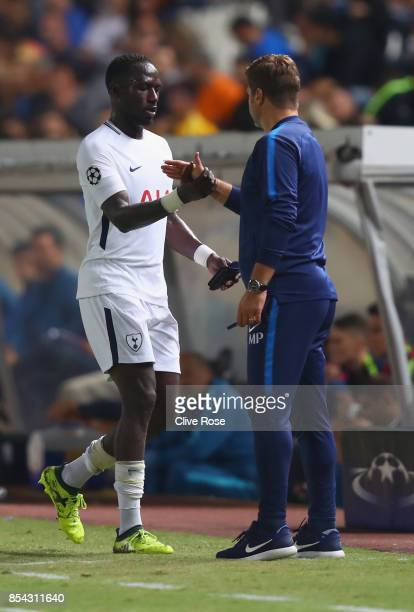 Moussa Sissoko of Tottenham Hotspur and Mauricio Pochettino Manager of Tottenham Hotspur embrace after he is subbed during the UEFA Champions League...