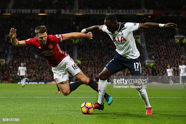 Moussa Sissoko of Tottenham Hotspur and Michael Carrick of Manchester United compete for the ball during the Premier League match between Manchester...