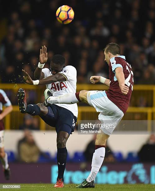 Moussa Sissoko of Tottenham Hotspur attempts to block Stephen Ward of Burnley shot during the Premier League match between Tottenham Hotspur and...