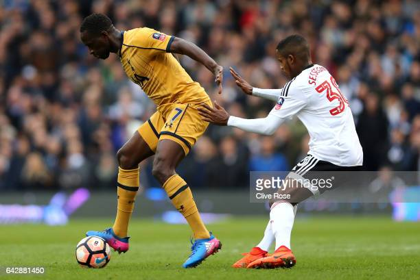 Moussa Sissoko of Tottenham Hotspur holds off Ryan Sessegnon of Fulham during The Emirates FA Cup Fifth Round match between Fulham and Tottenham...