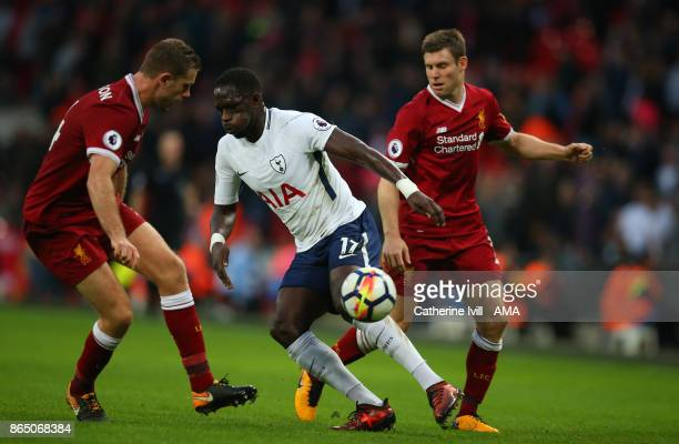 Moussa Sissoko of Tottenham Hotspur is marked by Jordan Henderson and James Milner of Liverpool during the Premier League match between Tottenham...