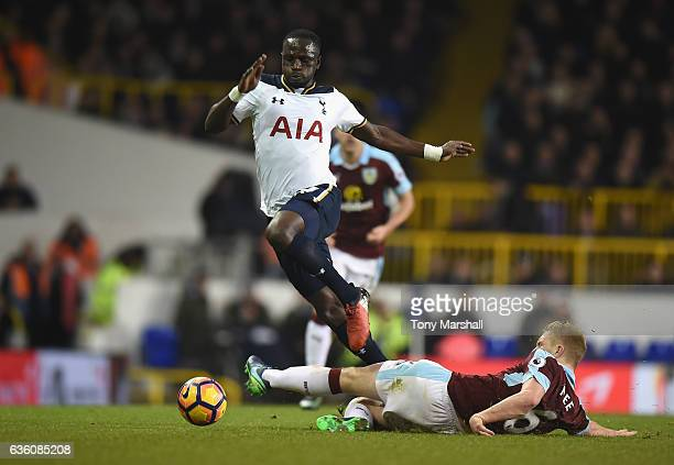 Moussa Sissoko of Tottenham Hotspur is tackled by Ben Mee of Burnley during the Barclays Premier League match between Tottenham Hotspur and Burnley...