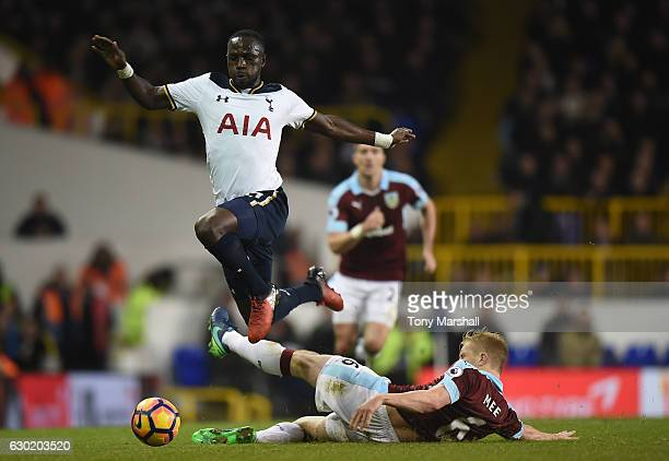 Moussa Sissoko of Tottenham Hotspur jumps over Ben Mee of Burnley challenge during the Premier League match between Tottenham Hotspur and Burnley at...