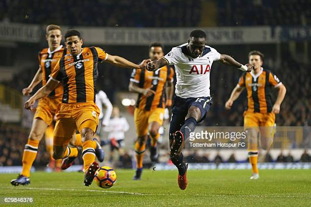 Moussa Sissoko of Tottenham Hotspur shoots while Curtis Davies of Hull City attempts to block during the Premier League match between Tottenham...