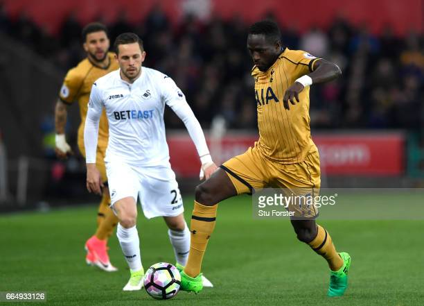 Moussa Sissoko of Tottenham Hotspur takes the ball away from Gylfi Sigurdsson of Swansea City during the Premier League match between Swansea City...