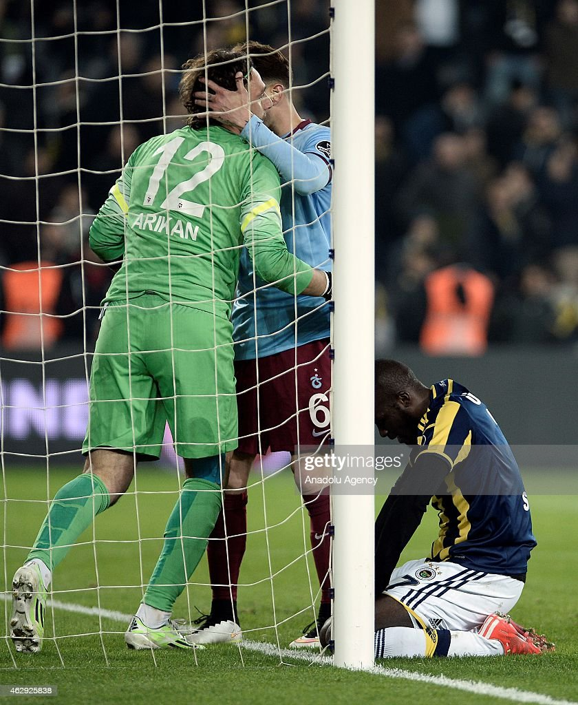<a gi-track='captionPersonalityLinkClicked' href=/galleries/search?phrase=Moussa+Sow&family=editorial&specificpeople=2336264 ng-click='$event.stopPropagation()'>Moussa Sow</a> (R)of Fenerbahce reacts after a position during the Turkish Spor Toto Spor League soccer match between Fenerbahce and Trabzonspor at Sukru Saracoglu Stadium in Istanbul, Turkey on February 07, 2015.