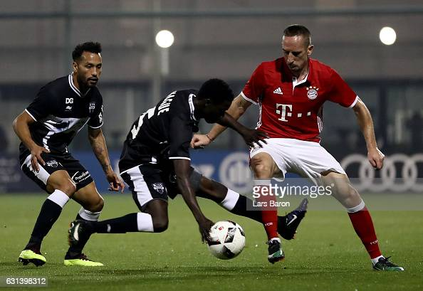 Moussa Wague of Eupen challenges Franck Ribery of Muenchen during the friendly match between Bayern Muenchen and KAS Eupen on January 10 2017 in Doha...