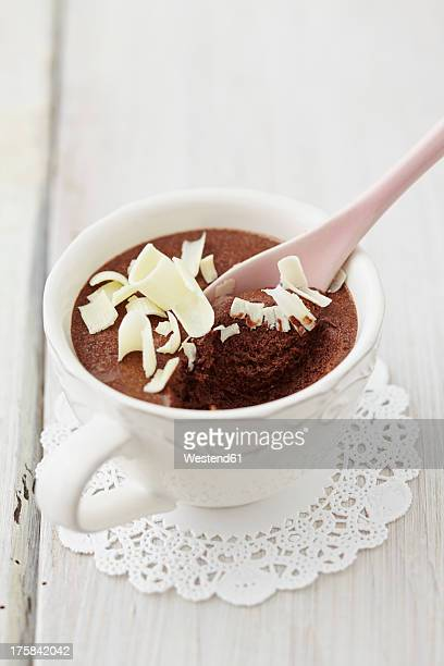 Mousse au Chocolat with grated white chocolate in cup on table