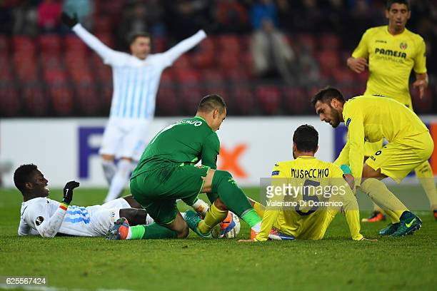 Mousse Kone of FC Zurich competes for the ball with Sergio Asenjo Mateo Musacchio and Victor Rui of Villareal during the UEFA Europa League match...