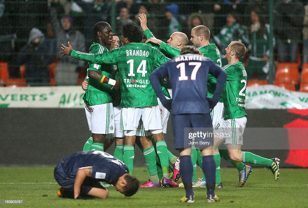 Moustapha Sall, Brandao of Saint-Etienne and teammates celebrate after tying the game while Thiago Silva of PSG lies on the field and Maxwell looks on during the Ligue 1 match between AS Saint-Etienne ASSE and Paris Saint-Germain FC at the Stade Geoffroy-Guichard on March 17, 2013 in Saint-Etienne, France.