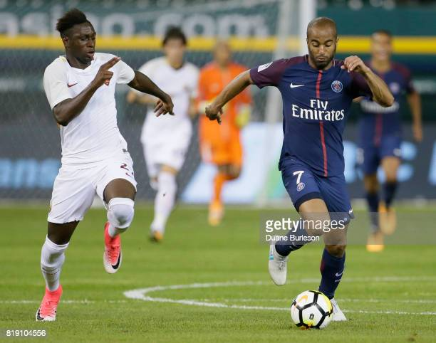 Moustapha Seck of AS Romaduring pursues Lucas Moura of Paris SaintGermain down the pitch during the second half at Comerica Park on July 19 2017 in...