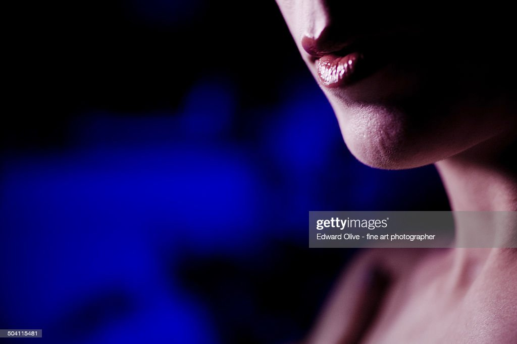Mouth of young lady wearing lipstick : Stock Photo