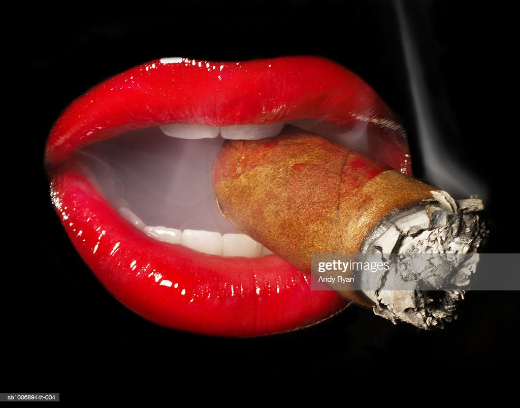Mouth smoking cigar, close-up, studio shot : Stock Photo