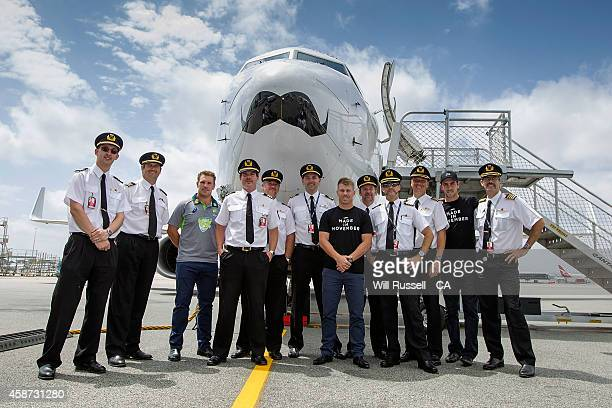 Movember Mo Bros Darren Lehmann Glenn Maxwell Aaron Finch David Warner pose with Qantas pilots and the Qantas Mo Plane at Perth Airport on November...