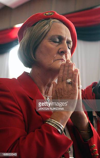 Movement for Democratic Change Secretary for Welfare Kerry Kay prays on May 17 2013 at the official opening of the three day MDC Policy Conference in...