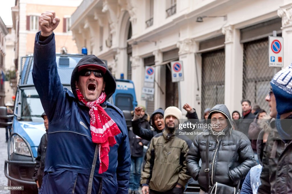 Movement for the right to housing and migrants demonstrate against Lega Nord party leader Matteo Salvini on December 10, 2017 in Rome, Italy. The northern League called a demonstration against the 'Ius Soli' law as Italy's centre-left government was forced to delay a vote on a law granting citizenship to immigrants' children born in Italy.