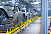 Modern automobile production line, automated production equipment. Shop for the Assembly of new modern cars. The way of Assembly of the car on the Assembly line at the plant