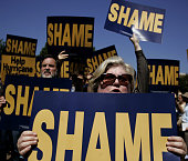 MoveOn PAC member Catherine Giovannoni of Arlington Virginia joins other members and supporters as they picketed in protest of the Bush...