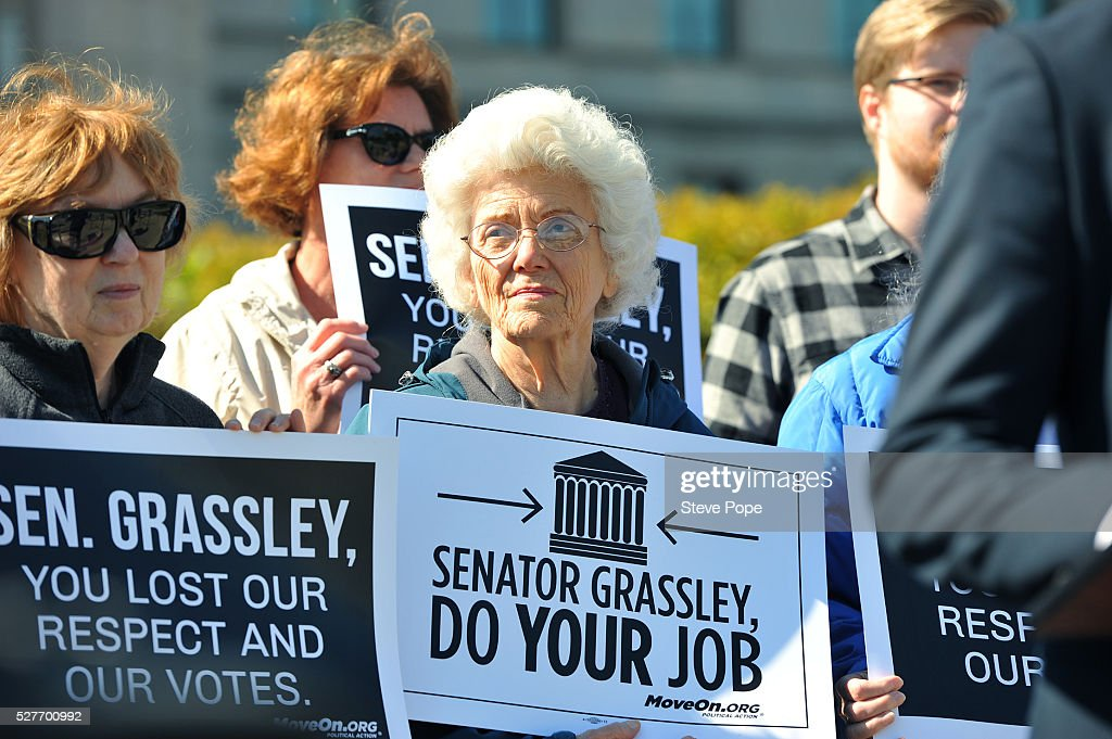 MoveOn.Org supporters hold signs at a MoveOn.org event named 'Senator Grassley, Do Your Job Or Lose The Respect And Votes' on May 3, 2016 in Des Moines, Iowa.