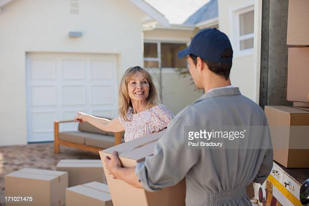 Mover helping woman move into new home