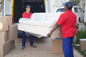 Movers carrying sofa to new home