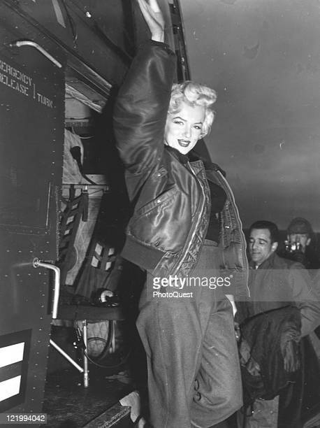 Movie actress Marilyn Monroe in Korea with the USO Campshow 'Anything Goes' steps off the helicopter after arriving and poses for photographers while...