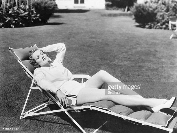 Movie actress Marlene Dietrich takes it easy in a beach chair
