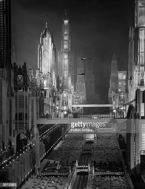 A movie art director's futuristic idea of how New York will look in 1980 with various traffic levels skyscrapers aeroplanes and dirigible landings...
