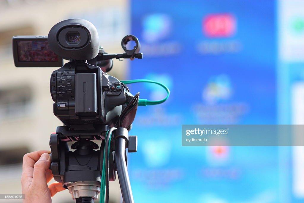 Movie camera filming blurred background