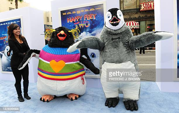 Movie characters Lovelace voiced by Robin Williams and Mumble voiced by Elijah Wood pose on arrival for the world premiere of the movie 'Happy Feet...