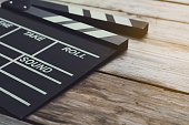 movie clapper on wood table ; film, cinema and video photography concept
