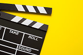 movie clapper on yellow background