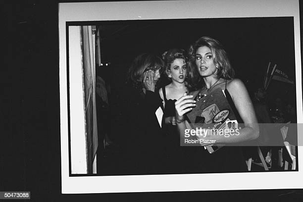 Movie dir/actress Penny Marshall actress Bitty Schram modelMTV hostess Cindy Crawford chatting at premiere party for the movie A League of Their Own...