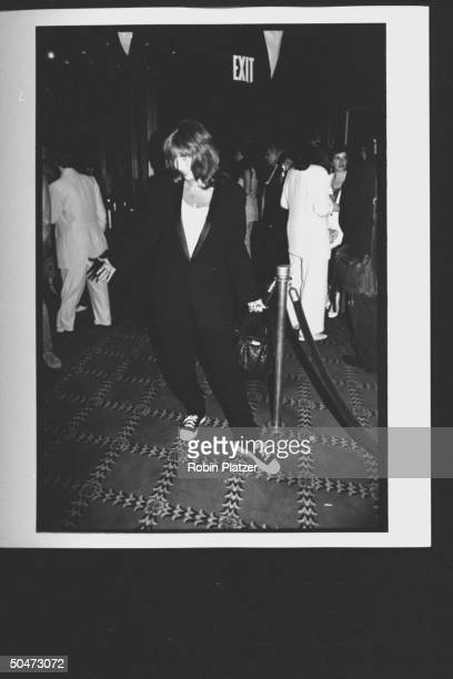 Movie dir/actress Penny Marshall sporting black pantsuit black sequined sneakers posing in Ziegfield Theater lobby at premiere of her film A League...